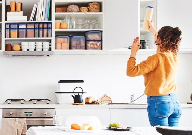 Woman setting up her dream kitchen